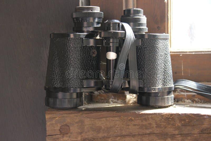 Vintage binoculars. Retro binoculars in black color. Vintage binoculars. The old binoculars, Retro binoculars. Black binoculars. Black color stock photos