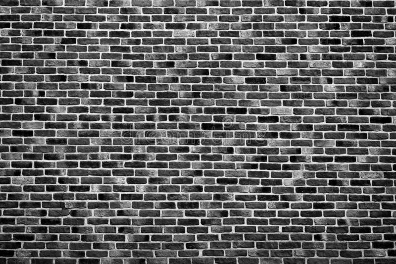 Vintage black brick wall background texture. Architecture grunge detail abstract theme. Home, office or loft design backdrop style.  royalty free stock photos