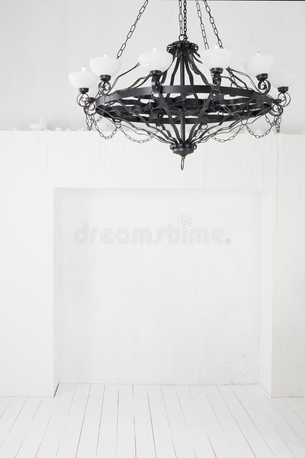 Vintage black chandelier with candles in an empty room stock photo download vintage black chandelier with candles in an empty room stock photo image 34053584 mozeypictures Gallery