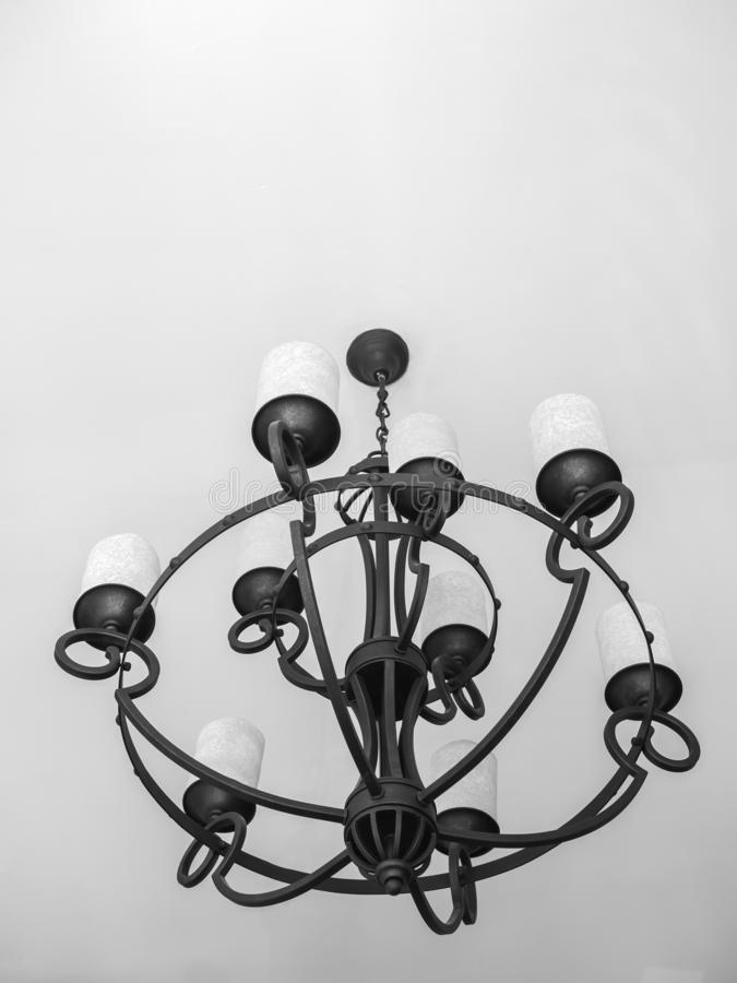 Vintage black chandelier with white candles stock image