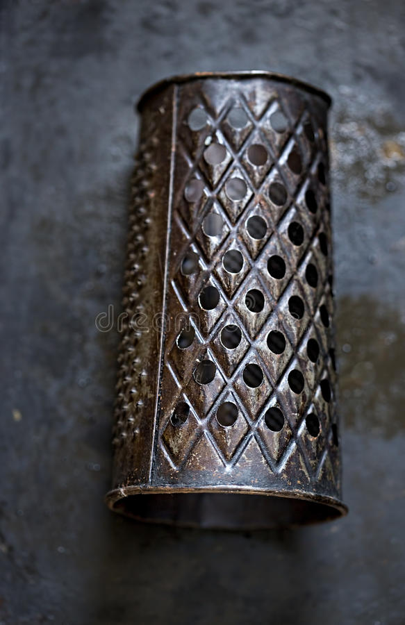Vintage black grater royalty free stock photography