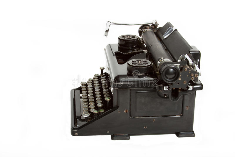 Vintage black manual typewriter. Side view of very old black manual typewriter stock photos