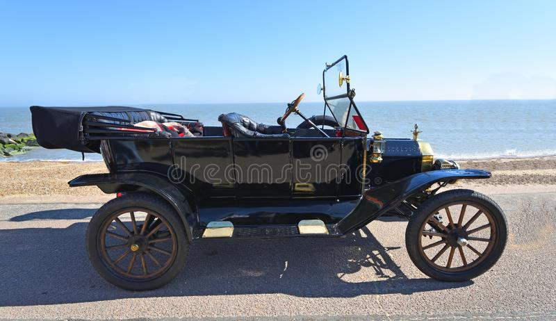 Vintage Black Model T Ford Motor Car Parked on Seafront Promenade. royalty free stock photos