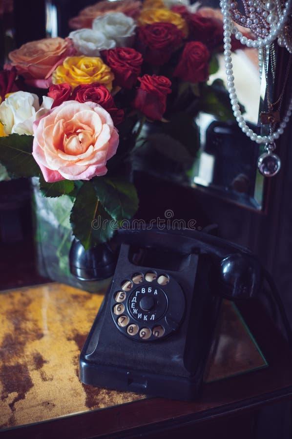 Vintage black rotary phone stock photos