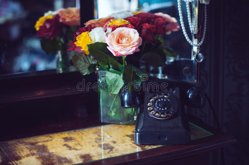 Vintage black rotary phone royalty free stock images