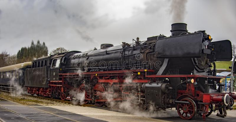 Vintage black steam powered railway train stock photo