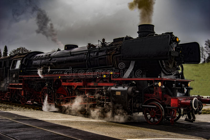 Vintage black steam powered railway train royalty free stock photography