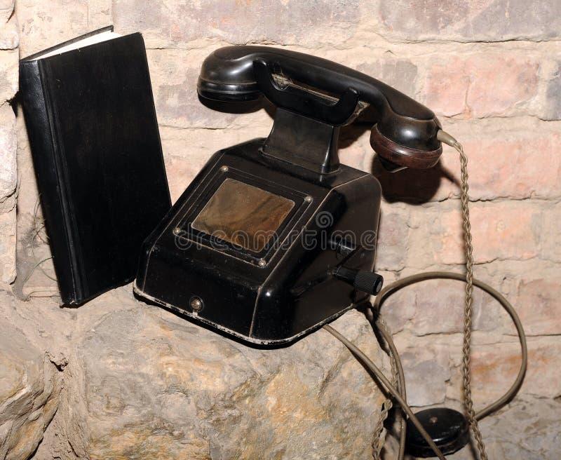 Vintage black telephone royalty free stock photography