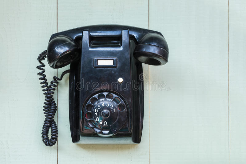 Vintage black wall telephone stock photography