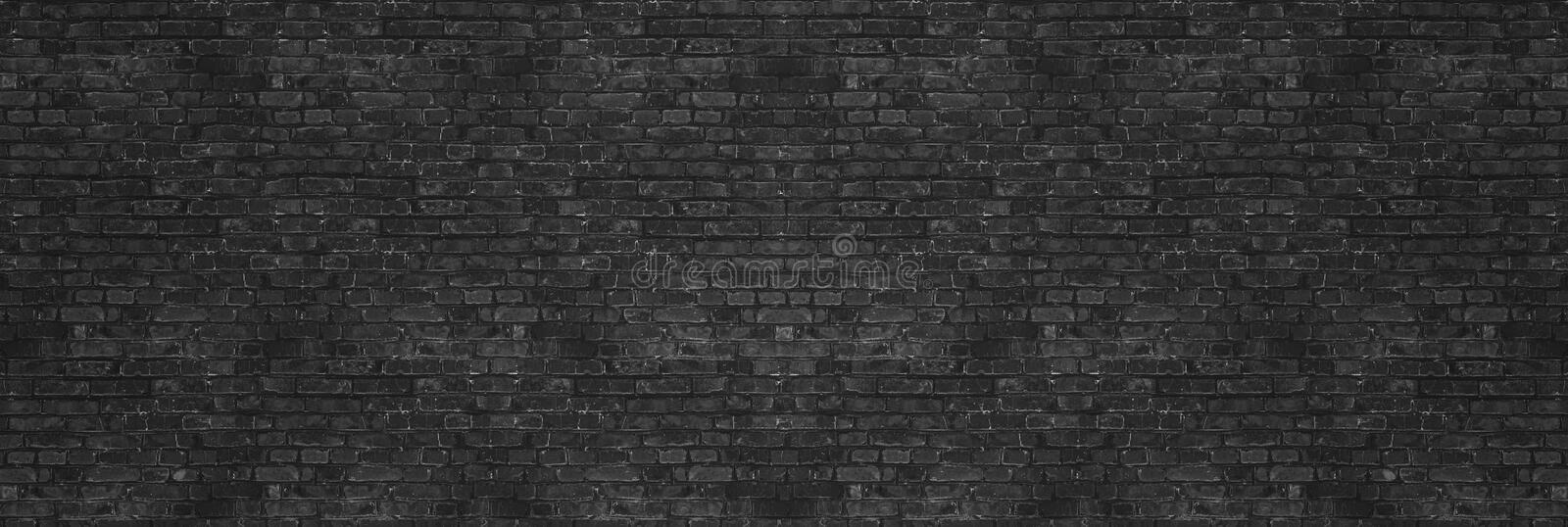 Vintage Black wash brick wall texture for design. Panoramic background for your text or image. royalty free stock photos