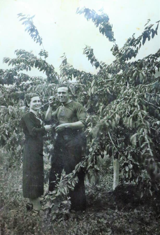 Vintage black and white photo of couple, 1950s European. royalty free stock photo