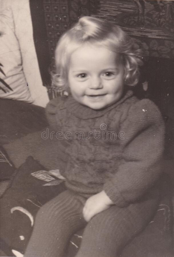 Vintage black and white photo of a young child smiling 1940s? stock image