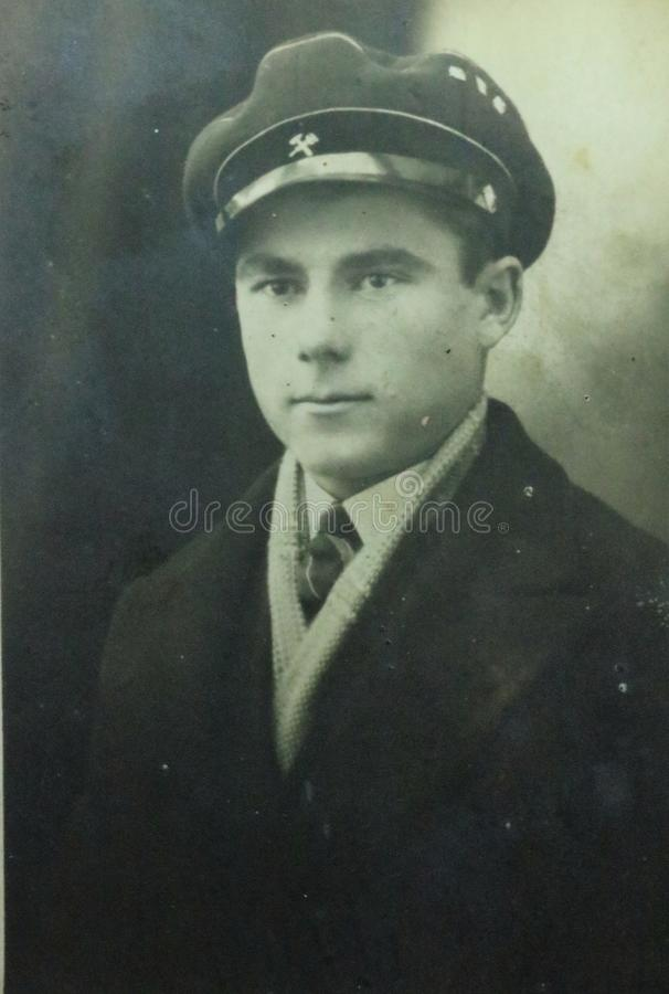 Vintage black and white photo of a young man in uniform 1950s European. stock photo