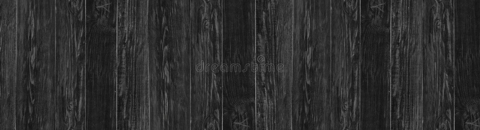 Vintage Black wood background. Dark wooden panoramic texture stock images