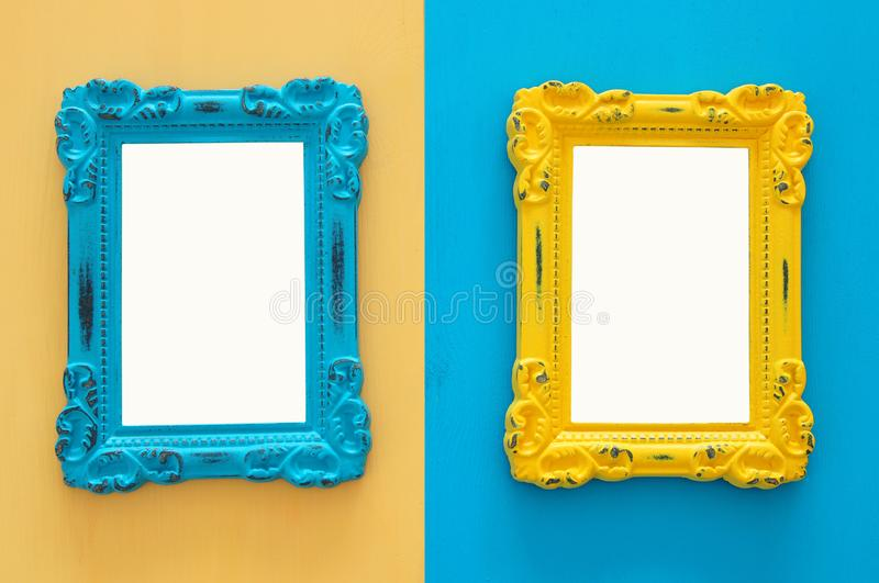 Vintage blank blue and yellow photo frames over double colorful background. Ready for photography montage. Top view from above. stock photo