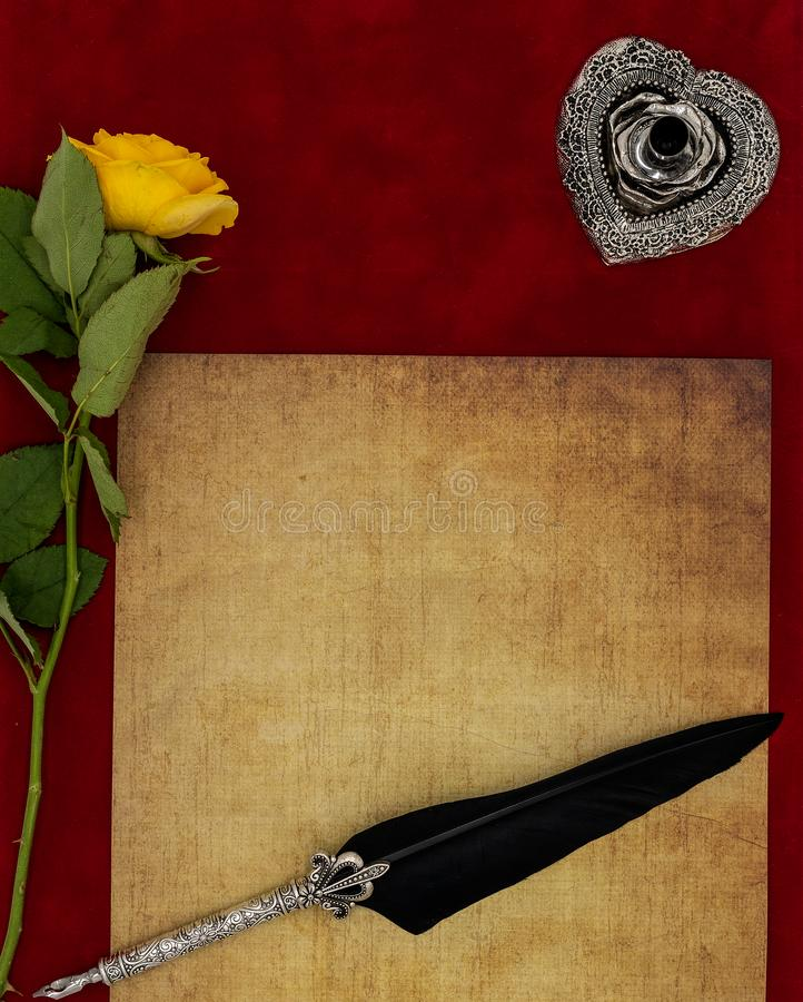 Vintage blank preachment, yellow rose, ornate silver quill stand and ornamented quill - Love letter concept. Antique blank preachment with yellow rose, detailed royalty free stock image
