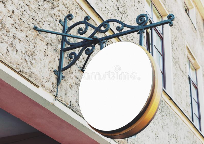 Vintage blank rounded outdoor restaurant sign. Mockup to add company logo royalty free stock image