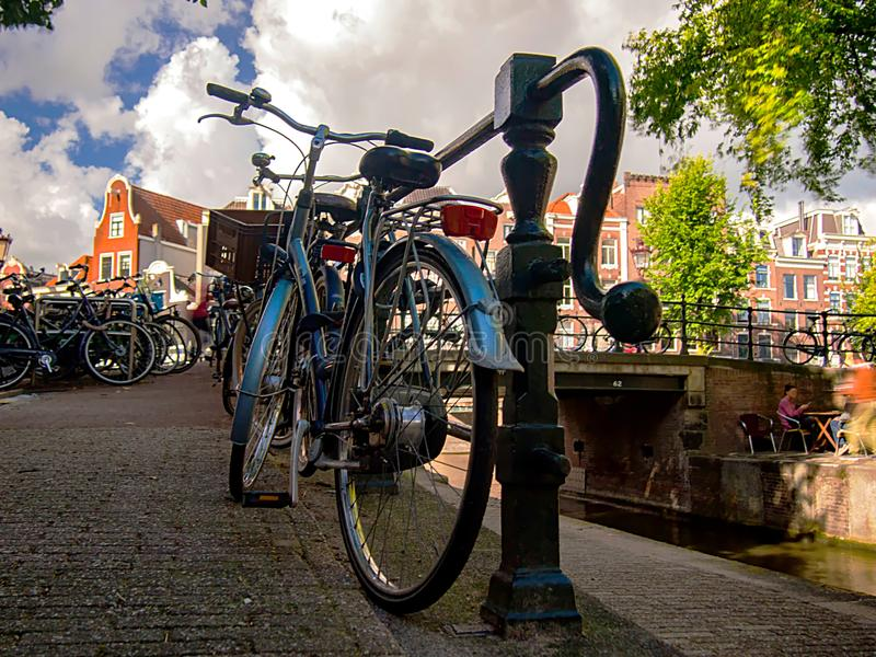 Vintage blue bicycle in Amsterdam stock images