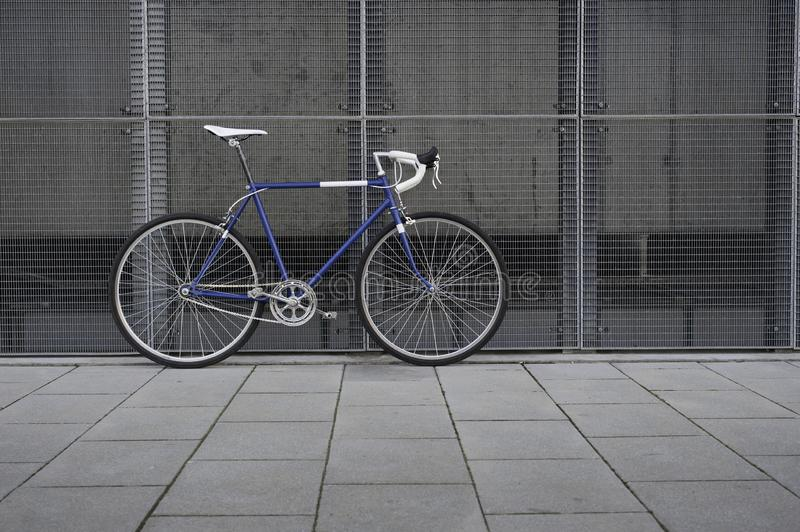 Vintage blue city, road bicycle with white details royalty free stock photo
