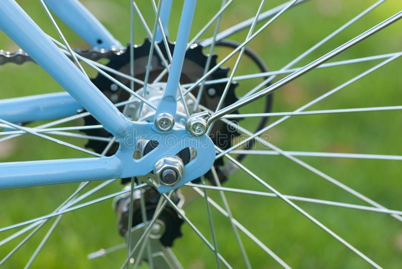 Vintage blue ladies bicycle part in the city park. With front and back baskets, 6 speed royalty free stock photography