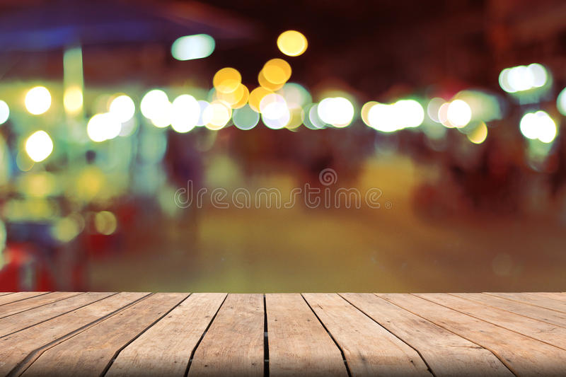 Vintage blurred background and wooden table on font. Abstract royalty free stock photos