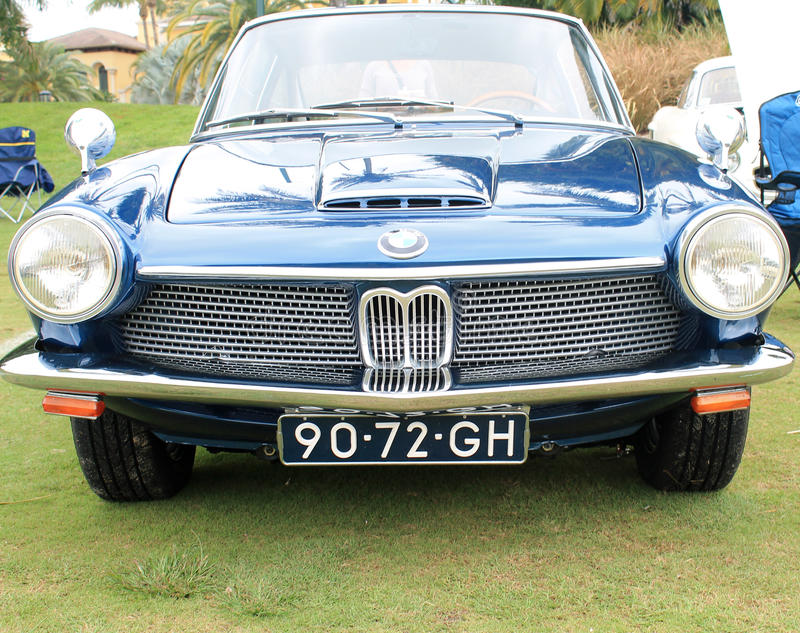 Vintage bmw sports car front close up. Vintage blue german sports car close up front view. 1967 bmw 1600 gt designed by frua at outdoors event. detail of front royalty free stock images