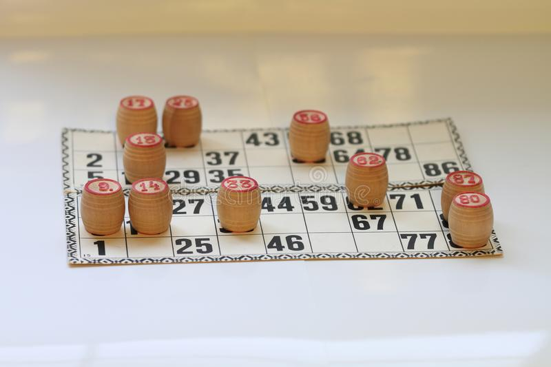Vintage board game lotto, kegs, wooden. Old royalty free stock photo