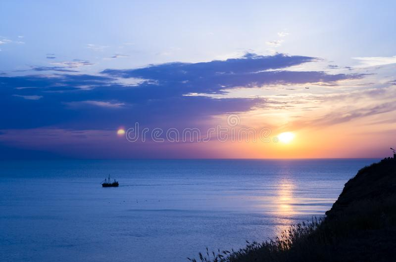 Vintage boat in the sea. sunset. Vintage boat in the sea. Beauty sunset stock images