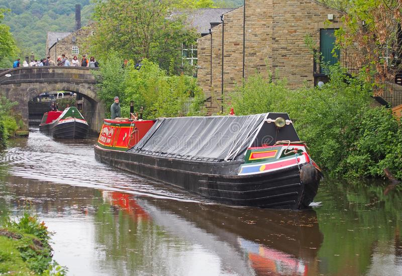 Vintage boats traveling to the historic narrow boat club gathering held on the may bank holiday on the rochdale canal at hebden. Hebden bridge, west yorkshire royalty free stock image