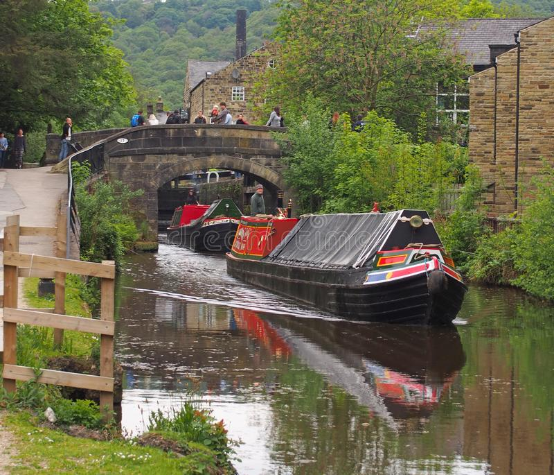Vintage boats traveling to the historic narrow boat club gathering held on the may bank holiday on the rochdale canal at hebden. Hebden bridge, west yorkshire stock images