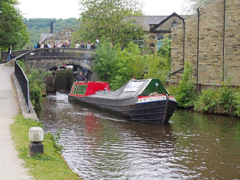 Vintage boats traveling to the historic narrow boat club gathering held on the may bank holiday on the rochdale canal at hebden. Hebden bridge, west yorkshire royalty free stock photos