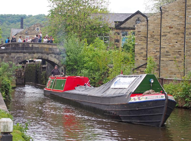 Vintage boats traveling to the historic narrow boat club gathering held on the may bank holiday on the rochdale canal at hebden. Hebden bridge, west yorkshire royalty free stock photo