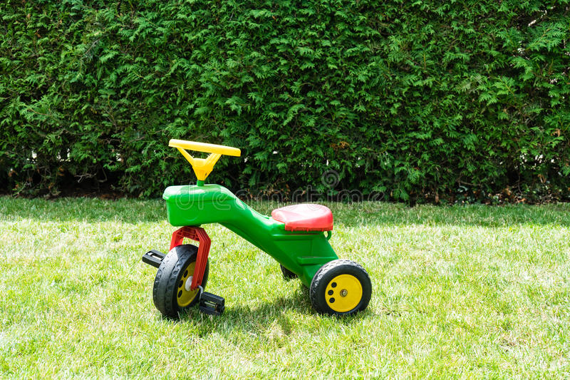 Vintage bobby car in meadow play toy kids stock image