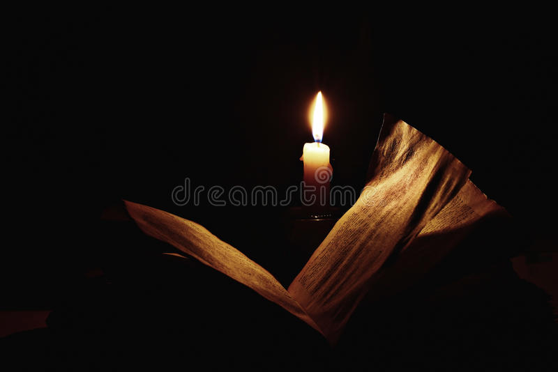 Vintage book candle stock image