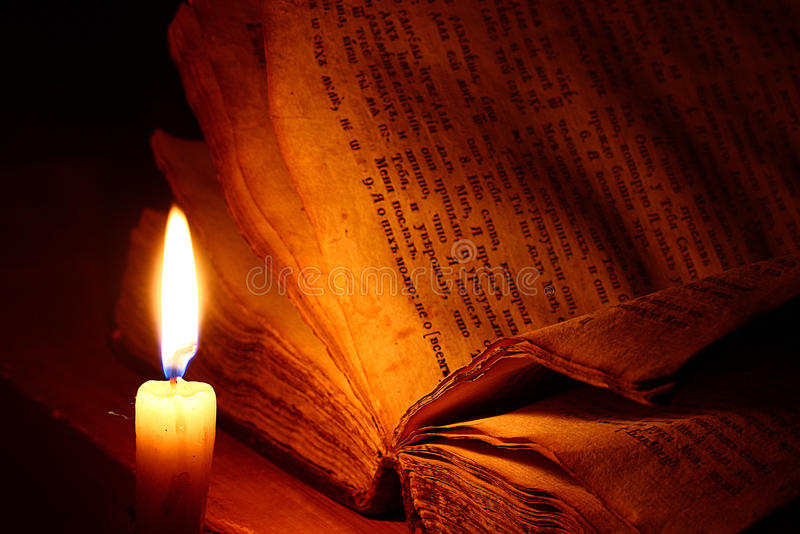 Vintage book candle royalty free stock photo