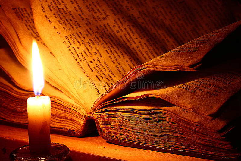 Vintage book candle royalty free stock photography