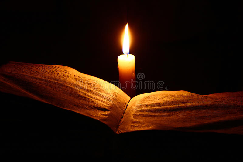 Vintage book candle royalty free stock image