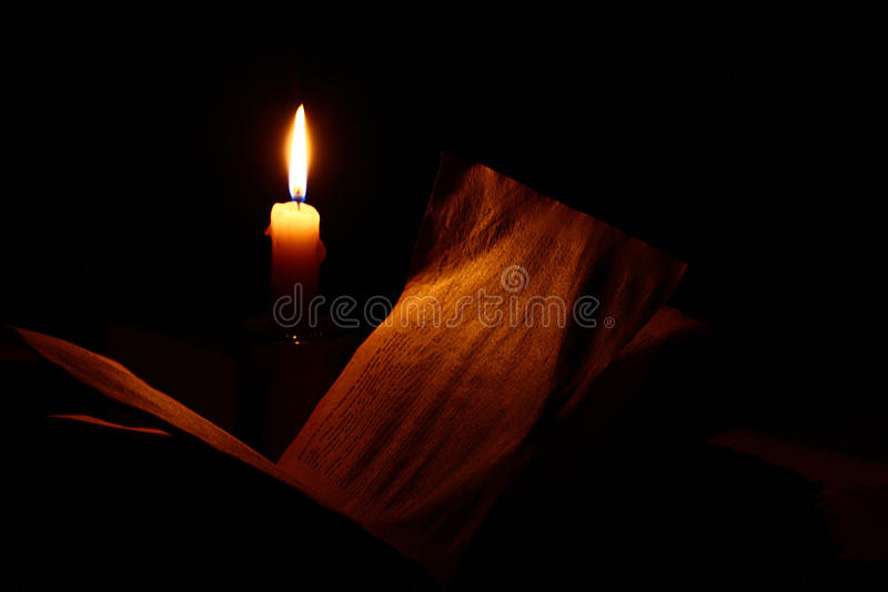 Vintage book candle stock photography