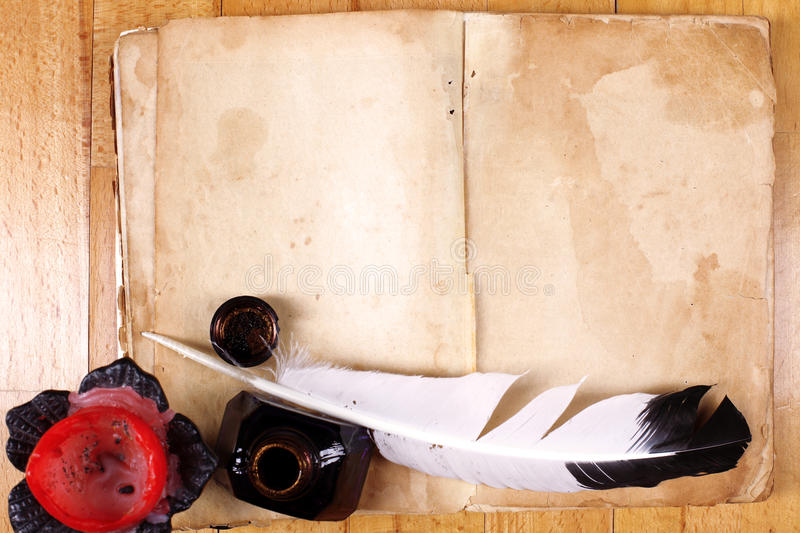 Vintage book, candle, feather royalty free stock photography