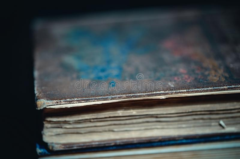 Vintage book cover background. Selective focus on book detail stock image