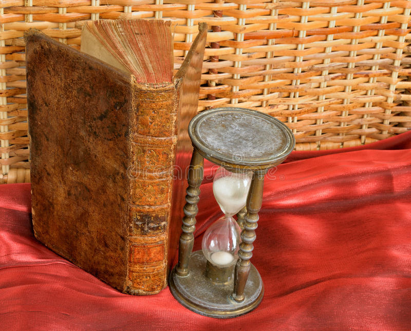 Vintage book and hourglass royalty free stock image