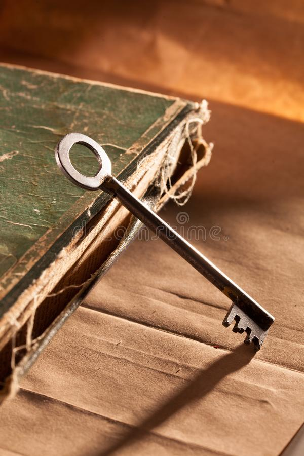 Vintage book and the key. Concept photo. Vintage book and the key. Concept photo royalty free stock images