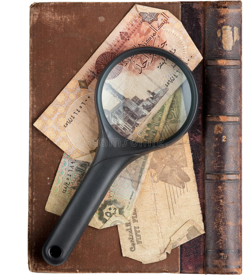 Vintage Book With Magnifying Glass Royalty Free Stock Photos