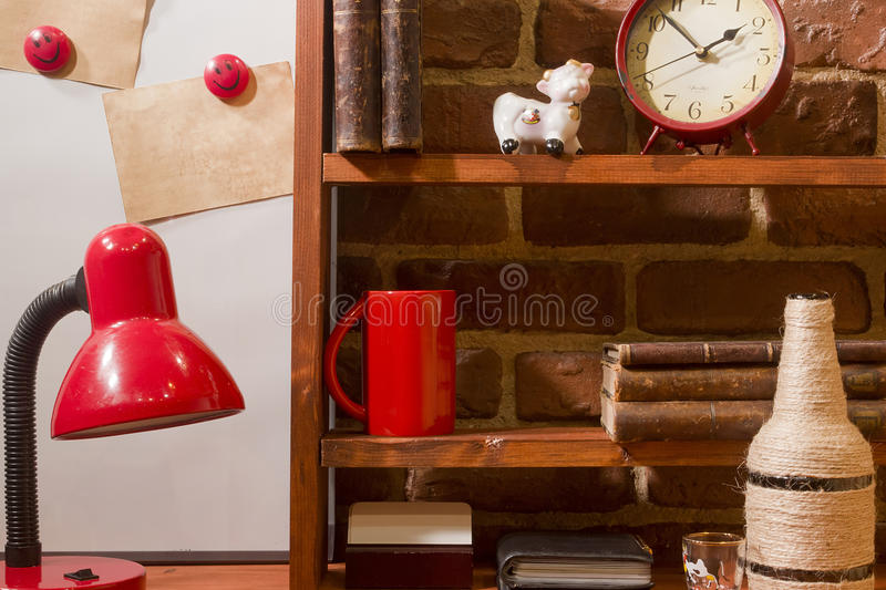 Vintage books coffee cup and desk lamp on the table. stock photo