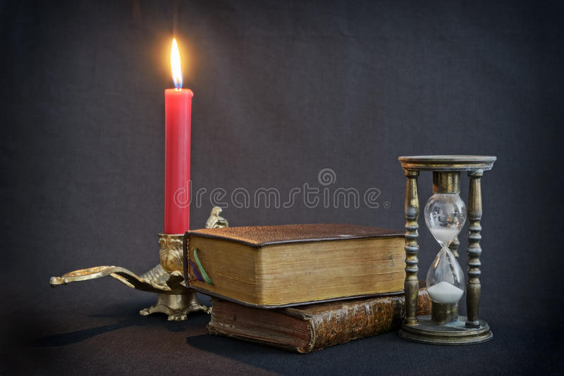 Vintage books and hourglass stock photo