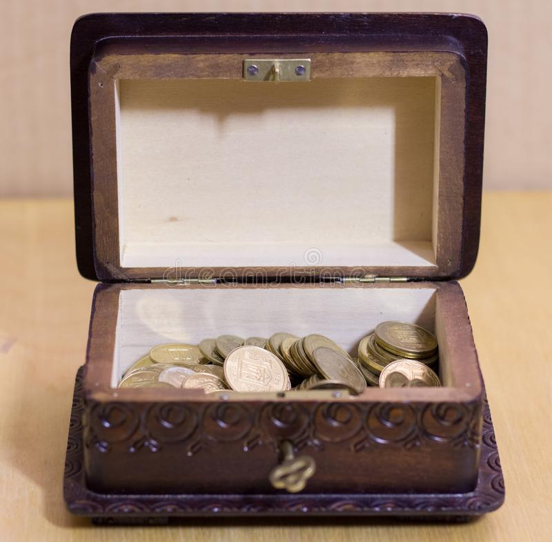 Vintage box with coins. Vintage box with different coins stock photo