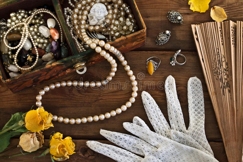 Vintage box with trinkets and jewelry royalty free stock images