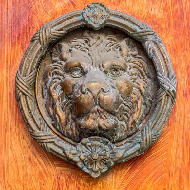 Vintage brass door knocker - lion head royalty free stock photography