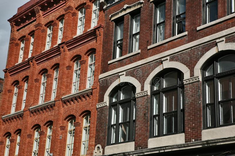 Old city brick business Buildings in Quebec city stock images
