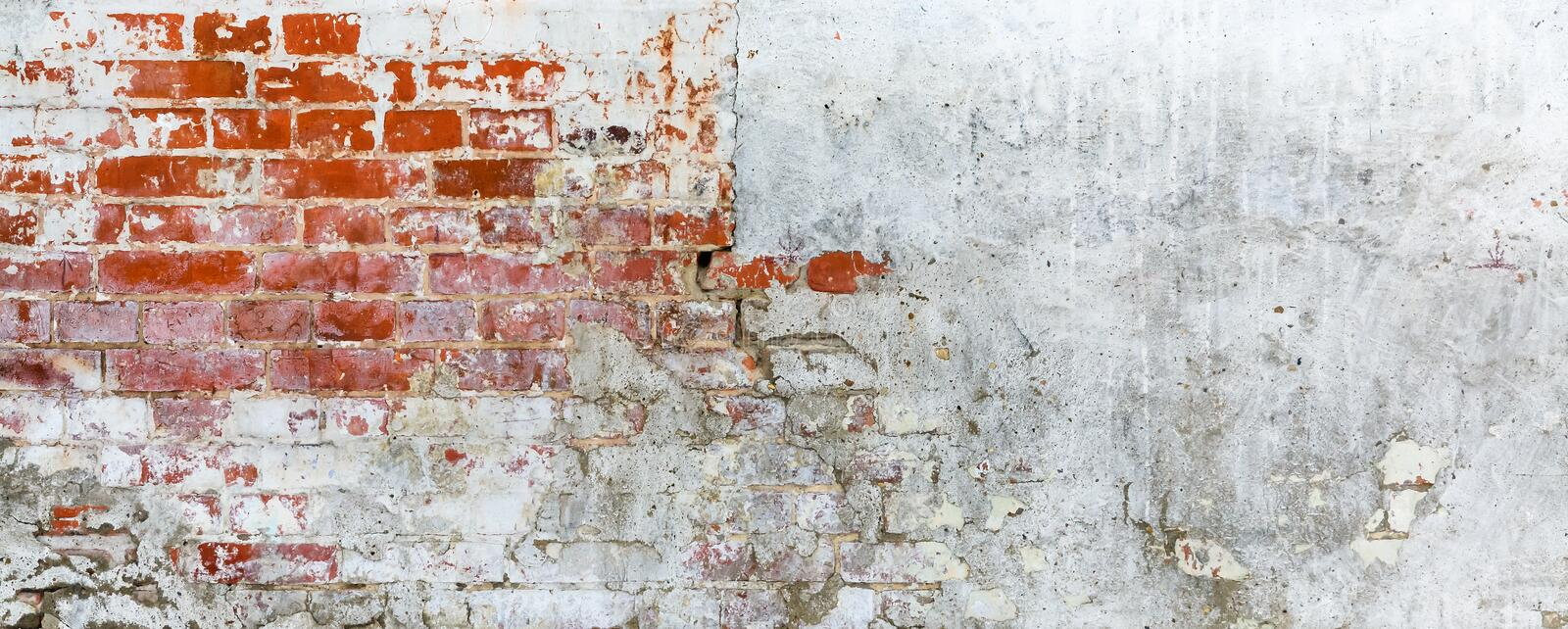Vintage brick rough rustic wall with cracked plaster stock photos